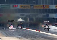 Apr 27, 2014; Baytown, TX, USA; NHRA top fuel dragster driver Steve Torrence (left) races alongside Terry McMillen during the Spring Nationals at Royal Purple Raceway. Mandatory Credit: Mark J. Rebilas-