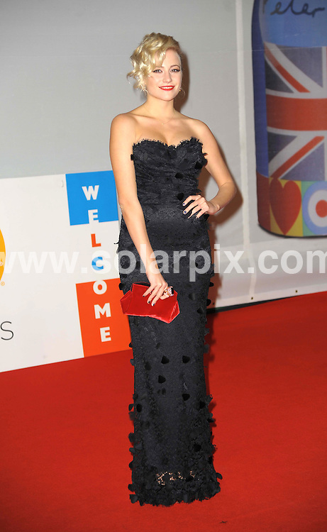 **ALL ROUND PICTURES FROM SOLARPIX.COM**                                             **WORLDWIDE SYNDICATION RIGHTS**                                                                                  Stars arrive at London's O2 Arena for the 2012 Brit Awards..This pic:  Pixie Lott                                                            .JOB REF:    14495   MSR     DATE:   22.02.12                                                         **MUST CREDIT SOLARPIX.COM OR DOUBLE FEE WILL BE CHARGED**                                                                      **MUST AGREE FEE BEFORE ONLINE USAGE**                               **CALL US ON: +34 952 811 768 or LOW RATE FROM UK 0844 617 7637**
