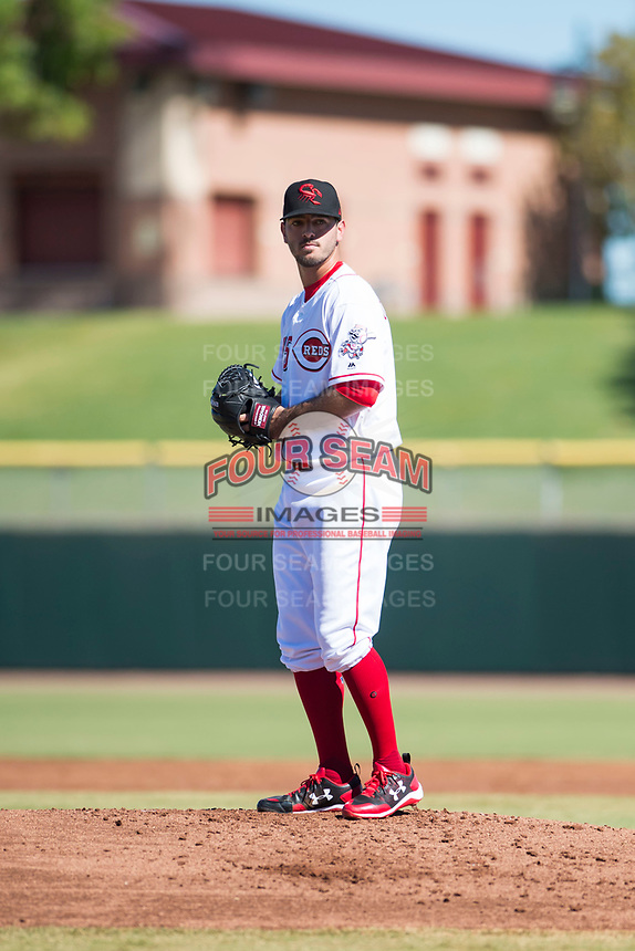Scottsdale Scorpions starting pitcher Austin Orewiler (75), of the Cincinnati Reds organization, gets ready to deliver a pitch during an Arizona Fall League game against the Surprise Saguaros at Scottsdale Stadium on October 26, 2018 in Scottsdale, Arizona. Surprise defeated Scottsdale 3-1. (Zachary Lucy/Four Seam Images)