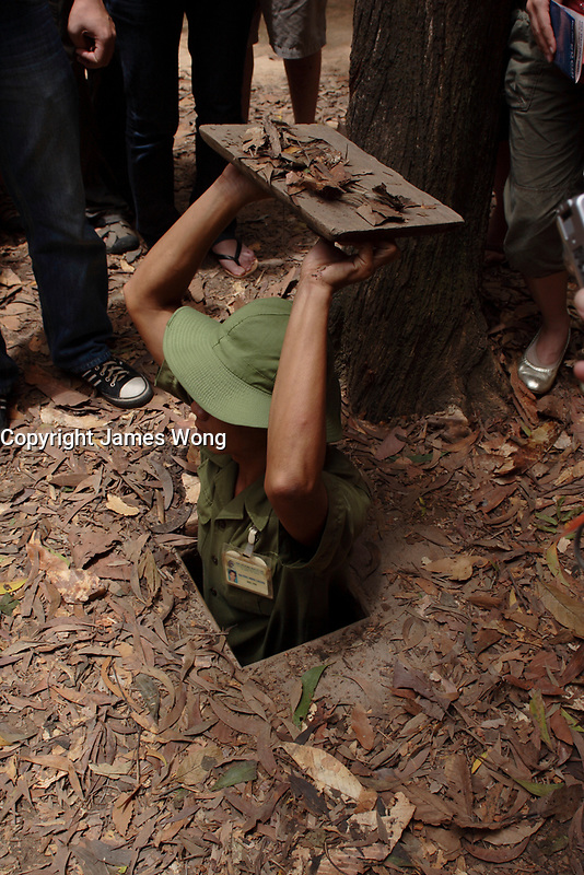 Ho Chi Minh city<br /> , Vietnam - 2007 File Photo -<br /> <br />  soldier shows  trap door to  Cu Chi tunnels.<br /> <br /> <br /> <br /> <br /> photo : James Wong-  Images Distribution