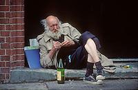Portrait of a man enjoying a bottle of wine in London in 1996