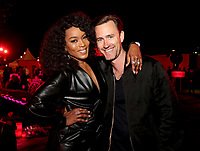 """LOS ANGELES - OCTOBER 26: (L-R) Angela Bassett and Executive Producer John Gray attend the red carpet event to celebrate 100 episodes of FX's """"American Horror Story"""" at Hollywood Forever Cemetery on October 26, 2019 in Los Angeles, California. (Photo by John Salangsang/FX/PictureGroup)"""