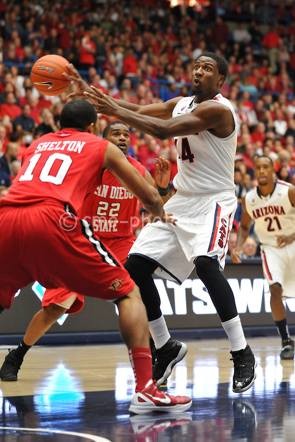 Nov 23, 2011; Tucson, AZ, USA; Arizona Wildcats forward Solomon Hill (44) makes a no-look pass in the first half of a game against the San Diego State Aztecs at the McKale Center.  Mandatory Credit: Chris Morrison-US PRESSWIRE