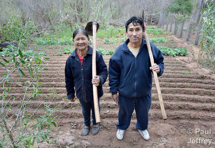 Justina Romero and her husband, Adolfo Torres, pose together in their garden in the Guarani indigenous village of Kapiguasuti, Bolivia. They and their neighbors started the gardens with assistance from Church World Service, supplementing their corn-based diet with nutritious vegetables and fruits.