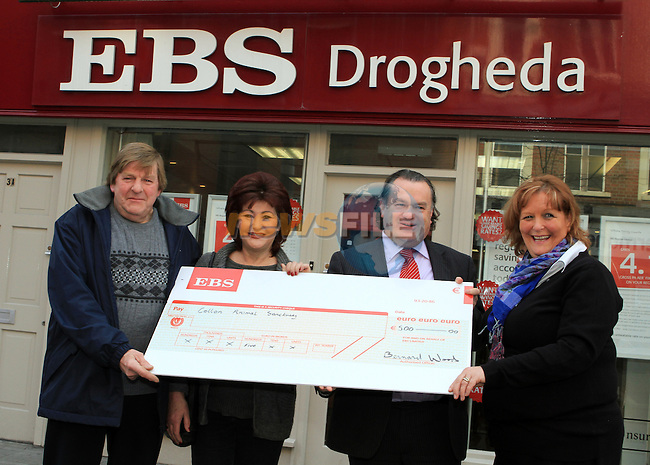 George and Lynne Archer from Collon Animal Sanctuary accept a cheque from Bernard Woods and Lucia Britton in EBS, Drogheda...(Photo credit should read Jenny Matthews www.newsfile.ie)....This Picture has been sent you under the conditions enclosed by:.Newsfile Ltd..The Studio,.Millmount Abbey,.Drogheda,.Co Meath..Ireland..Tel: +353(0)41-9871240.Fax: +353(0)41-9871260.GSM: +353(0)86-2500958.email: pictures@newsfile.ie.www.newsfile.ie.