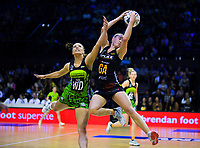 Monica Faulkner beats Karin Burger to the ball during the ANZ Premiership netball match between Central Pulse and WBOP Magic at TSB Bank Arena in Wellington, New Zealand on Sunday, 21 April 2019. Photo: Dave Lintott / lintottphoto.co.nz
