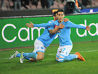 Jose Callejon   Christian Maggio  celebrates after scoring during the Italian Serie A soccer match between SSC Napoli and AS Roma   at San Paolo stadium in Naples, March 09 , 2014