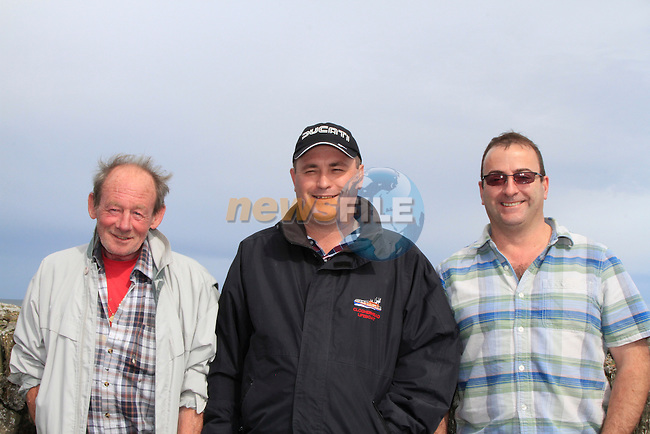 Michael Diamond, Denis Levins and Sean Reilly on the pier during the &quot;Blessing of the Boats&quot; on Sunday 10th August 2014.<br /> Picture:  Thos Caffrey / www.newsfile.ie