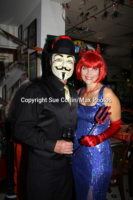 Guiding Light's Frank Dicopoulos and his wife Teja Anderson are host and judge of the Halloween party on October 30, 2010 at Sallee Tee's Grille in Monmouth Beach, New Jersey. He has a Vedetta mask on and Teja is the blue Devil. (Photo by Sue Coflin/Max Photos)