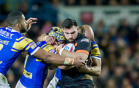 Picture by Allan McKenzie/SWpix.com - 23/03/2018 - Rugby League - Betfred Super League - Leeds Rhinos v Castleford Tigers - Elland Road, Leeds, England - Castleford's Matt Cook is tackled by Leeds's Ash Golding and Carl Ablett.