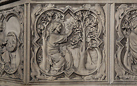 Detail of bas-relief sculpture, mid 13th century, on the base of the portal of the Upper chapel of La Sainte-Chapelle, Paris, France. One of a series of reliefs illustrating scenes from the Old Testament book of Genesis. Here we see God creating the fruit of the trees. Each panel has a decorated curly frame with mythical beasts in the corner. Sainte Chapelle was built 1239-48 to house King Louis IX's collection of Holy Relics. It is a UNESCO World Heritage Site. Picture by Manuel Cohen.