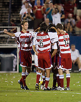 FC Dallas players celebrate a goal.  New England Revolution defeated FC Dallas 3-2 to capture the 2007 Lamar Hunt U.S. Open Cup at Pizza Hut Park in Frisco, TX on October 3, 2007.