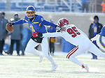 BROOKINGS, SD - NOVEMBER 17: Taryn Christion #3 from South Dakota State University scrambles away from Nick Kramer #95 from the University of South Dakota during their game Saturday afternoon at Dana J. Dykhouse Stadium in Brookings, SD. (Photo by Dave Eggen/Inertia)