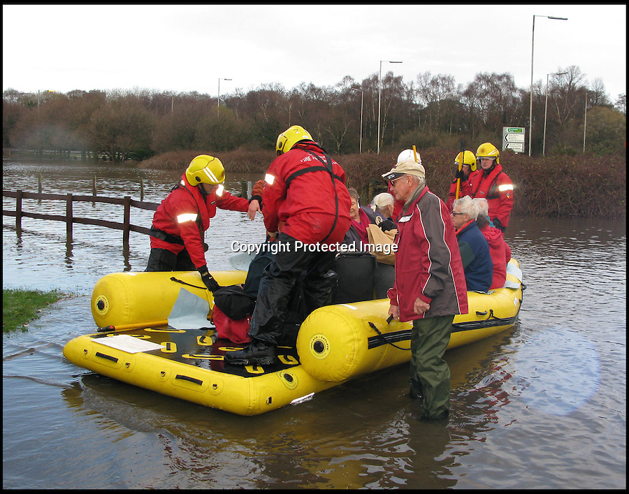 BNPS.co.uk (01202 558833)<br /> Pic: SimonRowley/BNPS<br /> <br /> ***Please Use Full Byline***<br /> <br /> Christchurch Firemen had to rescue the residents of Gladelands caravan park near Ferndown in Dorset today as the Uddens river flooded their homes. Residents were brought out on the brigades floating raft.