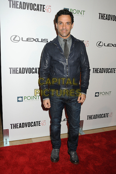 George Kotsiopoulos.The Advocate 45th Benefiting The Point Foundation held at the Beverly Hilton Hotel, Beverly Hills, California, USA..March 29th, 2012.full length jeans denim blue leather jacket.CAP/ADM/BP.©Byron Purvis/AdMedia/Capital Pictures.