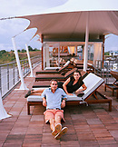 PERU, Amazon Rainforest, South America, Latin America, portrait of Francsco Galli Zugaro and his wife on the roof deck of their MV Aqua Boat.