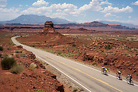 Cyclists pedal along the upper rim of White Canyon en route to HIte Crossing on Lake Powell and the end of the more-than-400-mile ride. The Red Rock Canyons Tour, organized by Lizard Head Cycling Tours, wound through 400 miles of the desert southwest. The route traveled through canyons and national monuments in Colorado, Utah and Arizona, ending at Lake Powell. (Kevin Moloney for the New York Times)