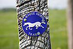 Close up of way marker sign for the White Horse Trail in Wiltshire, England, UK.  The White Horse Trail is a 90 mile walk taking in all 8 existing white horses cut into the Wiltshire hills.