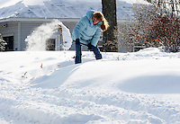 Barb Jansen shovels out after the winter snowstorm on Sunday, December 22, 2013, in Madison, Wisconsin