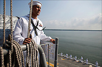 QM2 Scott Lopez, from San Antonio, Tx., during the departure of the maiden voyage of the Wasp-class, LHD 8 USS Makin Island, from Pascagoula, Ms., July 10, 2009.