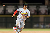 Surprise Saguaros catcher Jeremy Martinez (4), of the St. Louis Cardinals organization, hustles towards third base during an Arizona Fall League game against the Scottsdale Scorpions at Scottsdale Stadium on October 15, 2018 in Scottsdale, Arizona. Surprise defeated Scottsdale 2-0. (Zachary Lucy/Four Seam Images)