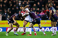 Picture by Alex Whitehead/SWpix.com - 16/03/2018 - Rugby League - Betfred Super League - St Helens v Leeds Rhinos - Totally Wicked Stadium, St Helens, England - St Helens' Zeb Taia is tackled by Leeds' Kallum Watkins and Brad Singleton.