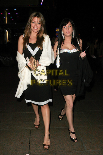 "REBECCA LOOS & GUEST.Afterparty for the premiere of ""What Happens In Vegas"", Casino, London, England..April 22nd, 2008.after party full length white dress black wrap shawl gold clutch bag .CAP/AH.©Adam Houghton/Capital Pictures."