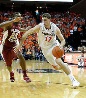 during the an NCAA basketball game Saturday Feb. 22, 2014 in Charlottesville, VA. (AP Photo/Andrew Shurtleff)