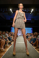 """Designer Night"" runway show during St. Charles Fashion Week in St. Charles, MO on Aug 24, 2012."