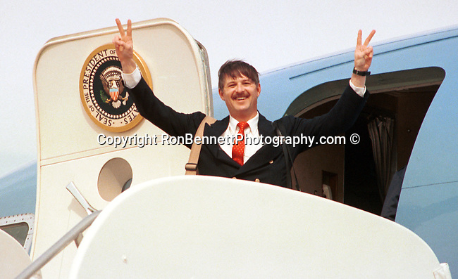 Ron Bennett on Presidents plane Air Force One, UPI White House Photographer Ron Bennett gives victory sign from Presidential air craft  Air Force One,  Ron Bennett Photographer, Ron Bennett Photography, Ronald T. Bennett Photography, Ronald T. Bennett, Fine Art Photography by Ron Bennett, Fine Art, Fine Art photography, Art Photography, Copyright RonBennettPhotography.com ©