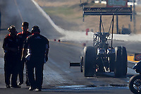 Jul. 26, 2013; Sonoma, CA, USA: Crew members look on as NHRA top fuel dragster driver Tommy Johnson Jr does a burnout during qualifying for the Sonoma Nationals at Sonoma Raceway. Mandatory Credit: Mark J. Rebilas-