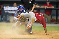 Oscar Mercado (4) of the Johnson City Cardinals slides into home plate ahead of the tag by Burlington Royals catcher Chase Vallot (8) at Burlington Athletic Park on July 14, 2014 in Burlington, North Carolina.  The Cardinals defeated the Royals 9-4.  (Brian Westerholt/Four Seam Images)