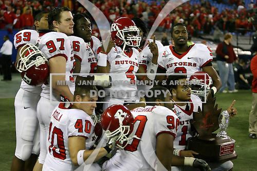 January 5th, 2008:  Rutgers players Josh LaVecchia (59), Pete Tverdov (97), Eric Foster (56), John Nicola (40), Jamaal Westerman (90), Chris Paul-Etienne (4), Damaso Munoz (17), and Marcus Daniels (9) pose with the championship trophy after the International Bowl at the Rogers Centre in Toronto, Ontario Canada...Rutgers defeated Ball State 52-30.  ..Photo By:  Mike Janes Photography