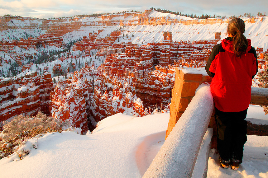 A visitor (MR) at Sunset Point during winter, Bryce National Park, Utah.  Model Released.