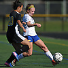 Caitlin McDonough #2 of Kellenberg, right, moves a ball upfield as Alyssa Lombardo #20 of Wantagh pressures her during a non-league varsity girls soccer game at Wantagh High School on Saturday, Sept. 29, 2018. Kellenberg won by a score of 3-0.