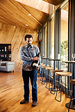 USA, Oregon, Willamette Valley, Eric holds a Magnum of wine inside the tasting room at Sokol Blosser Winery, Dayton