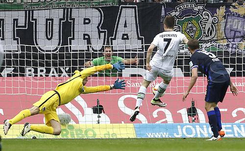 03.04.2016. Monchengladbach, Germany.  Bundesliga Football. Borussia Monchengladbach versus Hertha Berlin.  Patrick Herrmann BMG scores the goal for 3-0 against keeper Rune Jarstein BSC