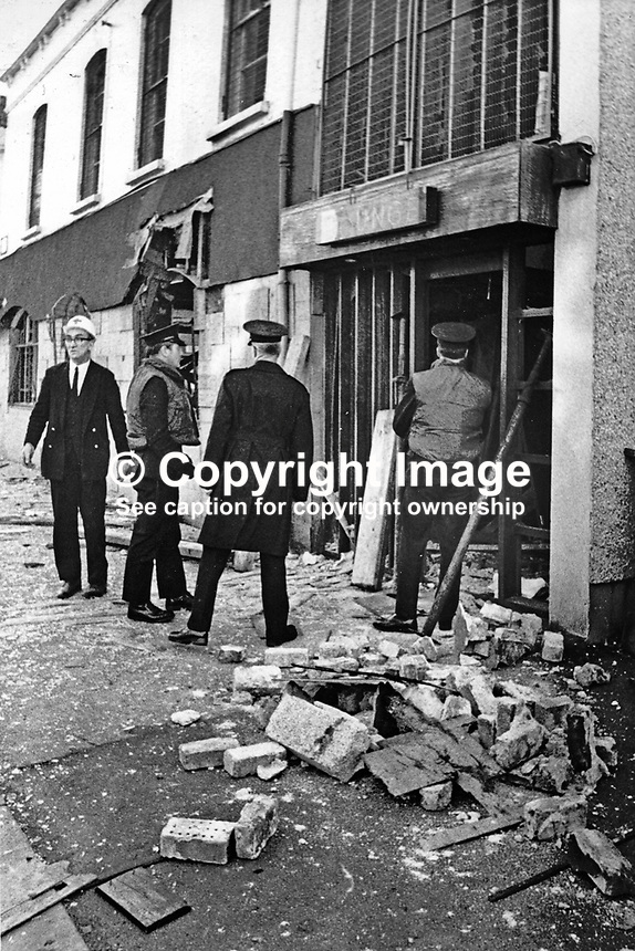 Police & an ambulanceman at the scene of the Provisional IRA bombing of Lavery's Bar, Lisburn Road, Belfast, N Ireland, 21st December 1971. The bar owner, John F Lavery, aka, Jack Lavery, died as he attempted to remove the bomb from the bar. 197112210514..Copyright Image from Victor Patterson, 54 Dorchester Park, Belfast, United Kingdom, UK...For my Terms and Conditions of Use go to http://www.victorpatterson.com/Victor_Patterson/Terms_%26_Conditions.html