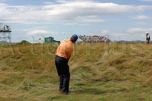 16 July 2005: View from behind South African golfer Retief Goosen (RSA) as he chips out of the rough on the 5th during his third round. Goosen shot a 6 under par 66 to be 9 under par after 3 rounds at The Open Championship, The Old Course at St Andrews, Scotland. Photo: Glyn Kirk/Actionplus....050716 golf major british