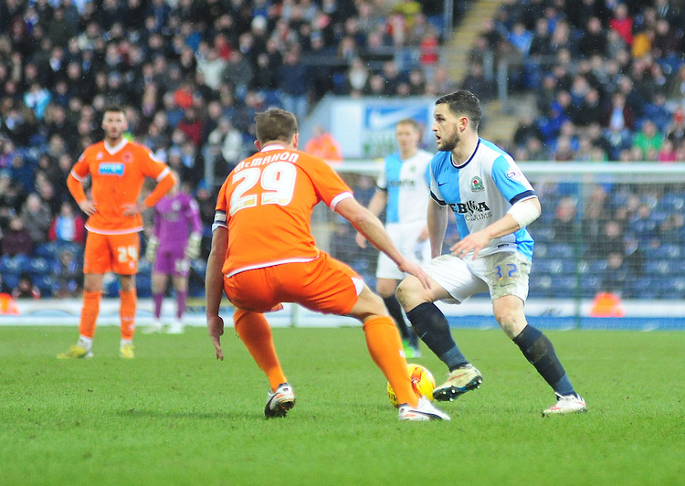 Blackburn Rovers' Craig Conway looks to gets past Blackpool's Anthony McMahon<br /> <br /> Photographer Andrew Vaughan/CameraSport<br /> <br /> Football - The Football League Sky Bet Championship - Blackburn Rovers v Blackpool - Saturday 21st February 2015 - Ewood Park - Blackburn<br /> <br /> &copy; CameraSport - 43 Linden Ave. Countesthorpe. Leicester. England. LE8 5PG - Tel: +44 (0) 116 277 4147 - admin@camerasport.com - www.camerasport.com