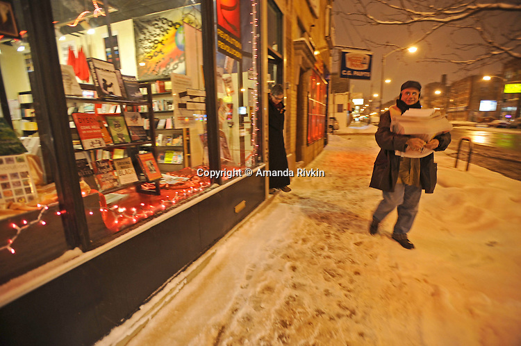 Grant Newburger, 50, a supporter of Bob Avakian's Revolutionary Communists leaves with a stack of Revolution newspapers and his wife following a discussion at the Revolution Bookstore approximately one mile from the once notorious and partially demolished Cabrini Green housing project where Newburger resides in Chicago, Illinois on February 12, 2008.