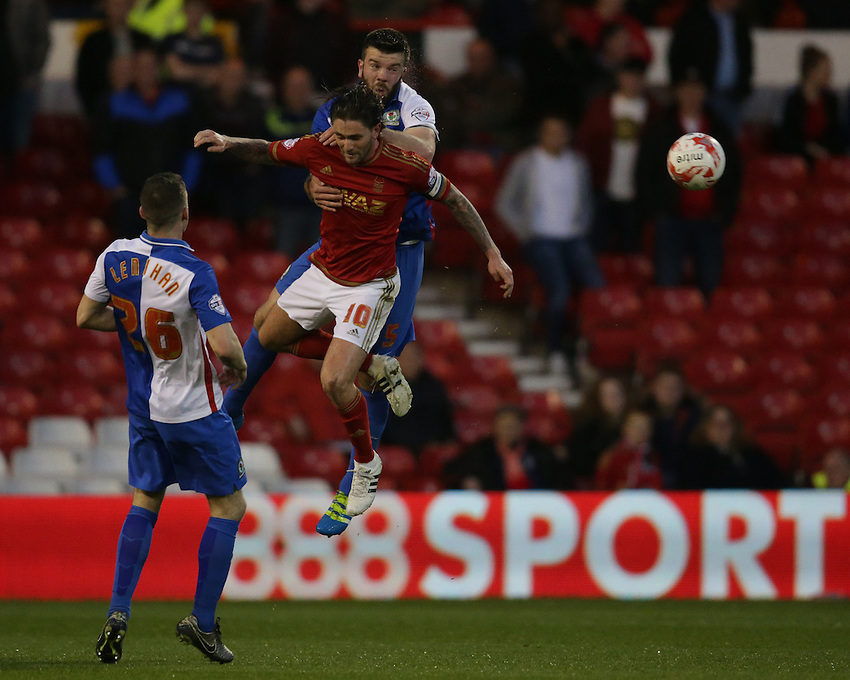 Nottingham Forest's Henri Lansbury and Blackburn Rovers' Grant Hanley in action during tonights match<br /> <br /> Photographer Rachel Holborn/CameraSport<br /> <br /> Football - The Football League Sky Bet Championship - Nottingham Forest v Blackburn Rovers - Tuesday 19th April 2016 - The City Ground - Nottingham<br /> <br /> &copy; CameraSport - 43 Linden Ave. Countesthorpe. Leicester. England. LE8 5PG - Tel: +44 (0) 116 277 4147 - admin@camerasport.com - www.camerasport.com