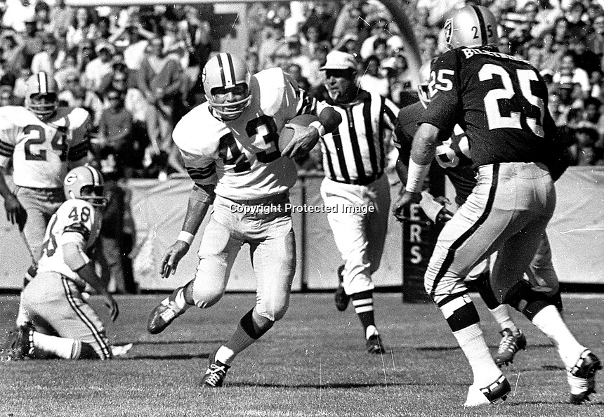 Raiders Fred Biletnikoff after Green Bay Pakers #53<br />Doug Hart intercepted pass...(1969 photo/Ron Riesterer)