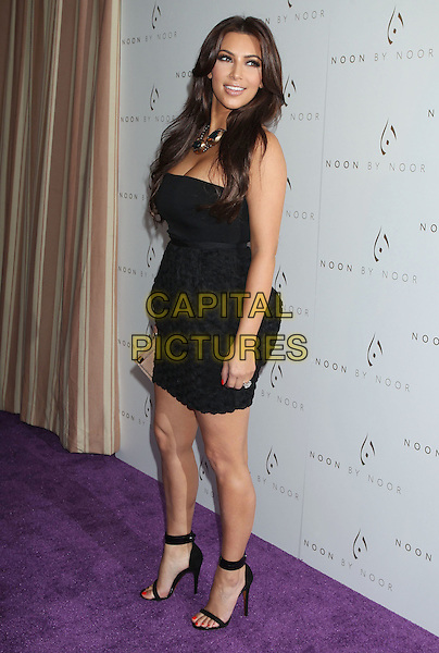 Kim Kardashian.'Noon by Noor' Launch Event held at the Sunset Tower Hotel, West Hollywood, California, USA..July 20th, 2011.full length black strapless dress skirt top circles necklace gold blue open toe sandals side.CAP/ADM/RE.©Russ Elliot/AdMedia/Capital Pictures.