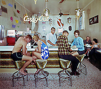 Safari Motel, Ocean City, Maryland, Teen couple sharing a drink in the motel coffee shop