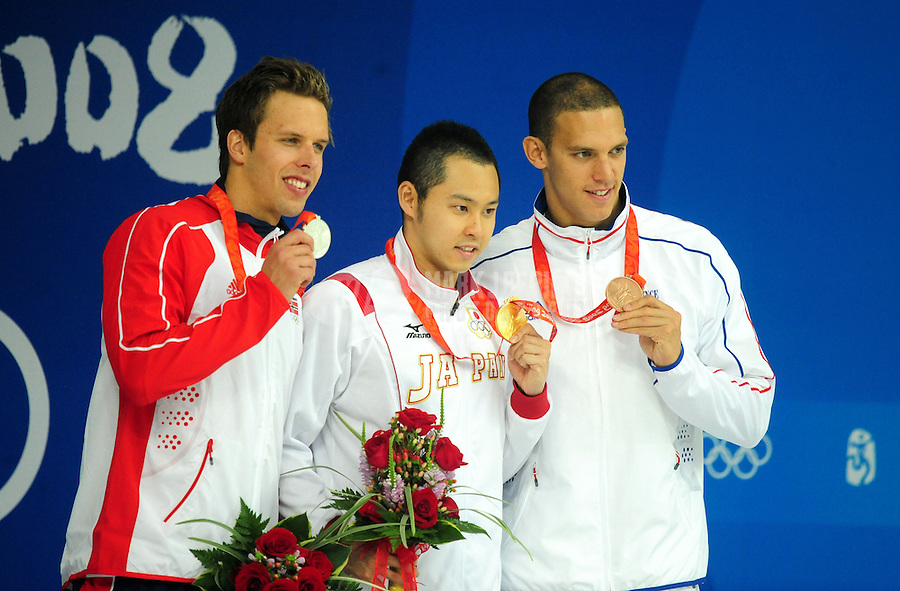 Aug. 11, 2008; Beijing, CHINA; (L-R) Silver medalist Alexander Dale Oen of Norway, gold medalist Kosuke Kitajima of Japan and bronze medalist Hugues Duboscq of France stand on the podium during the medal ceremony for the Men's 100m Breaststroke at the National Aquatics Center during the 2008 Beijing Olympics. Mandatory Credit: Mark J. Rebilas-