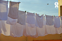 Hotel's towels drying on terrace (Licence this image exclusively with Getty: http://www.gettyimages.com/detail/93187581 )