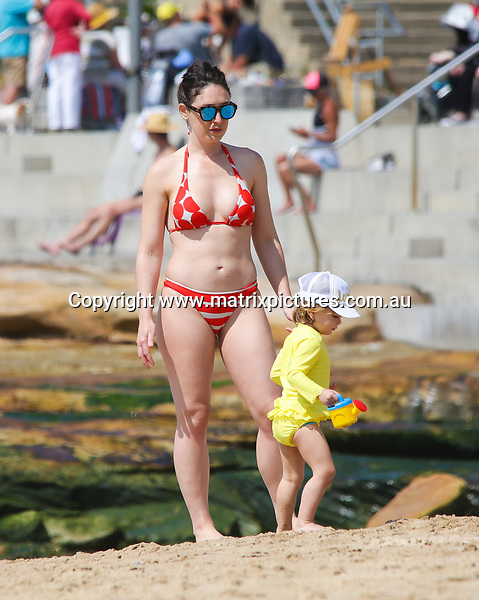 21 SEPTEMBER 2017 SYDNEY AUSTRALIA<br /> WWW.MATRIXNEWS.COM.AU<br /> <br /> EXCLUSIVE PICTURES<br /> <br /> Sara McGrath spotted showing off her toned body in two piece bikini at the beach. She was also accompanied by her daughter Maddison and Step daughter Holly.<br /> <br /> Note: All editorial images subject to the following: For editorial use only. Additional clearance required for commercial, wireless, internet or promotional use.Images may not be altered or modified. Matrix Media Group makes no representations or warranties regarding names, trademarks or logos appearing in the images.