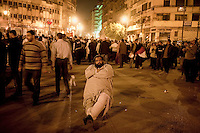 A protester sits on a chair in Tahrir Square. Continued anti-government protests take place in Cairo calling for President Mubarak to stand down. After dissolving the government, Mubarak still refuses to step down from power.