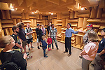 Sr. Research Scientist Wayne Prather tells visitors about the anechoic chamber at the NCPA open house which is a part of their 30th anniversary celebration. Photo by Kevin Bain/Ole Miss Communications